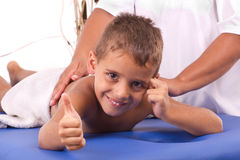 Smiling boy with the physiatrist in therapy Stock Photos