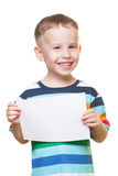Smiling boy with piece of paper. On isolated white Royalty Free Stock Photo