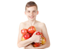 Smiling boy with a pile of apples stock photo