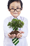 Smiling boy with plant in hands Royalty Free Stock Photo