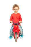 Smiling boy with plastic bike Royalty Free Stock Image