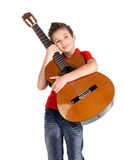 Smiling boy is playing the acoustic guitar Royalty Free Stock Images