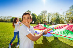 Smiling boy playing active game with friends Royalty Free Stock Photos