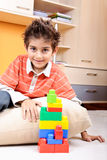 Smiling boy playing with construction set Royalty Free Stock Images