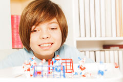 Smiling boy playing ice hockey table board game Royalty Free Stock Image