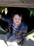 A smiling boy at the playing at the playground Royalty Free Stock Photography