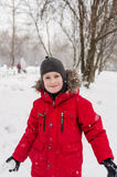 Smiling boy playing with snow Royalty Free Stock Photos