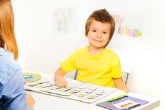 Smiling boy plays in game learn days of the week Royalty Free Stock Photos