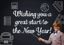 Smiling boy pointing at blackboard with new year greeting quotes Stock Photos