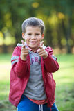 Smiling boy pointing with fingers to the camera, outdoors Royalty Free Stock Photo