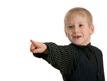 Smiling boy pointing forward Royalty Free Stock Photos