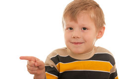 Smiling boy pointing right Stock Photo