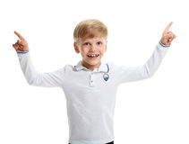 Smiling boy pointing two hands up Royalty Free Stock Photo