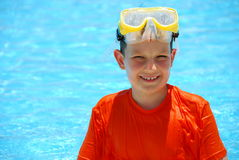 Smiling boy in pool Stock Images