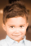 Smiling boy. Portrait of young boy smiling and looking into the camera Royalty Free Stock Photo
