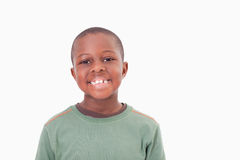 Smiling boy posing. Against a white a background royalty free stock images