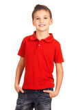 Smiling boy posing as a fashion model. Young pretty boy posing at studio as a fashion model. Photo of preschooler 8 years old over white background stock images