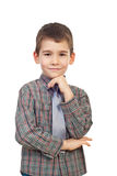 Smiling boy posing with hand to chin Royalty Free Stock Photography