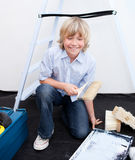 Smiling boy preparing paint Royalty Free Stock Photography