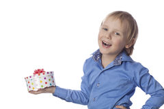 Small boy holds present and smiling Royalty Free Stock Image