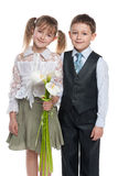 Smiling boy and pretty girl with flowers Royalty Free Stock Image