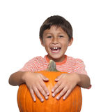 Smiling boy with pumpkin Stock Images