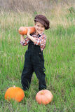 Smiling boy with pumpkins Royalty Free Stock Photo