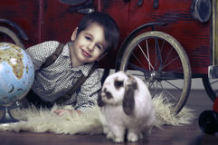 Smiling boy with rabbit Royalty Free Stock Images