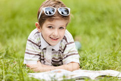 Smiling boy reading book outdoor Stock Photos
