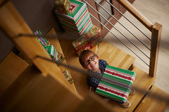 Smiling boy ready to open Christmas presents Royalty Free Stock Photo