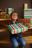 Smiling boy ready to open Christmas presents Royalty Free Stock Photography