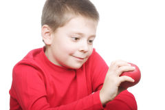 Smiling boy with red apple Royalty Free Stock Photos