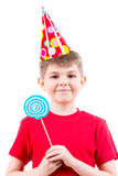 Smiling boy in red t-shirt  holding colored candy. Stock Images