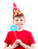 Smiling boy in red t-shirt  holding colored candy. Stock Photos