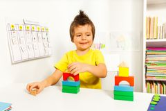 Smiling boy replicating example with color blocks Stock Photos