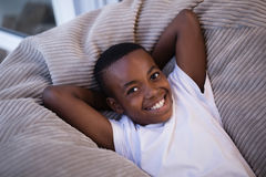 Smiling boy resting on couch at home Royalty Free Stock Images