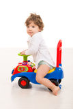 Smiling boy ride a big car toy Stock Photos