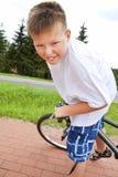 Smiling boy riding bike Royalty Free Stock Image
