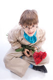 Smiling boy with roses royalty free stock photo