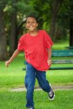 Smiling boy running out Royalty Free Stock Images