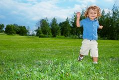 Smiling boy running in park Royalty Free Stock Photography