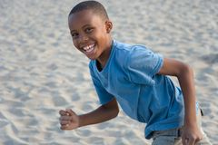 smiling boy running with sand Stock Image