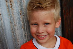 Smiling boy. With rustic background stock image