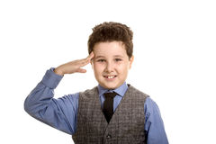 Smiling boy saluting like soldiers Stock Images