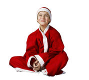 The smiling Boy in a Santa Claus outfit posing on a white backgr Stock Photos