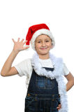 Smiling boy in Santa red hat Stock Images