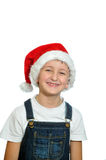 Smiling boy in Santa red hat Stock Photo