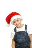 Smiling boy in Santa red hat Stock Photo