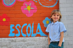 Smiling boy at the school wall Stock Image