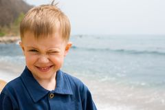 Smiling boy & sea Royalty Free Stock Image